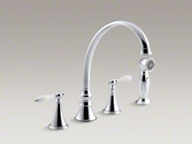 "Kohler Finial® Traditional 4-hole kitchen sink faucet with 9-3/16"" spout, matching finish sidespray and lever handles with White inserts K-377-4P"